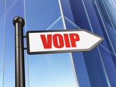 Web development concept: sign VOIP on Building background — Stockfoto