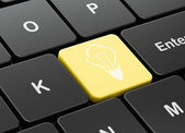Business concept: Light Bulb on computer keyboard background — Foto de Stock