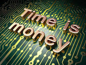 Time concept: Time is Money on circuit board background — Stock Photo
