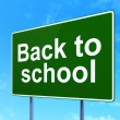 Education concept: Back to School on road sign background — Stock Photo