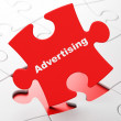 Marketing concept: Advertising on puzzle background — Stock Photo