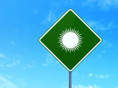 Travel concept: Sun on road sign background — Stock Photo