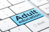Education concept: Adult Education on computer keyboard background — Stockfoto