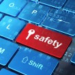 Protection concept: Key and Safety on computer keyboard background — Stock Photo #43772587
