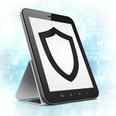 Safety concept: Contoured Shield on tablet pc computer — 图库照片