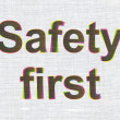 Protection concept: Safety First on fabric texture background — Stock Photo #43913077
