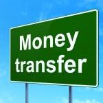 Постер, плакат: Finance concept: Money Transfer on road sign background