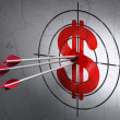 Currency concept: arrows in Dollar target on wall background — Stock Photo #43915565