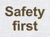 Protection concept: Safety First on fabric texture background — Stock Photo