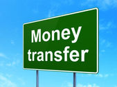 Finance concept: Money Transfer on road sign background — Stock Photo