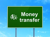 Business concept: Money Transfer and Finance Symbol on road sign background — Stock Photo