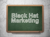 Finance concept: Black Hat Marketing on chalkboard background — Stockfoto