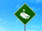 Safety concept: Cctv Camera on road sign background — Stock Photo