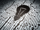 Finance concept: circuit board with Light Bulb — Stock Photo