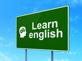 Education concept: Learn English and Head Gears on road sign — Stockfoto