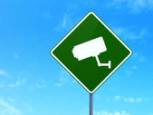 Privacy concept: Cctv Camera on road sign background — Stock Photo