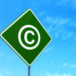 Law concept: Copyright on road sign background — Stock Photo #44020065