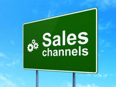 Advertising concept: Sales Channels and Gears on road sign background — Stock Photo