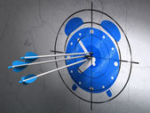 Time concept: arrows in Alarm Clock target on wall background — Stock Photo