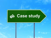 Education concept: Case Study and Gears on road sign background — Foto de Stock