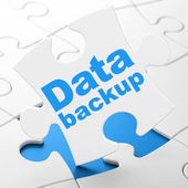 Information concept: Data Backup on puzzle background — Foto de Stock