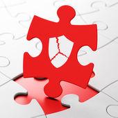 Privacy concept: Broken Shield on puzzle background — Stockfoto