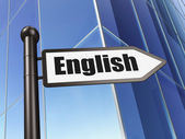 Education concept: sign English on Building background — Foto de Stock