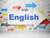 Education concept: arrow with English on grunge wall background — Stock Photo