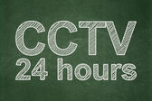 Privacy concept: CCTV 24 hours on chalkboard background — Stock Photo