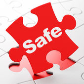Security concept: Safe on puzzle background — Stockfoto