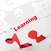 Education concept: Learning on puzzle background — Foto de Stock