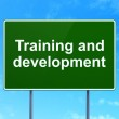 Education concept: Training and Development on road sign background — Stock Photo #44681819