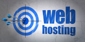 Web development concept: target and Web Hosting on wall background — Foto Stock