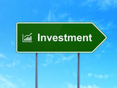 Finance concept: Investment and Growth Graph on road sign background — Stock Photo
