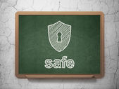 Privacy concept: Shield With Keyhole and Safe on chalkboard background — Photo