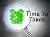 Timeline concept: Alarm Clock and Time To Taxes with optical glass — Zdjęcie stockowe