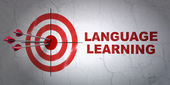 Education concept: target and Language Learning on wall background — Foto Stock