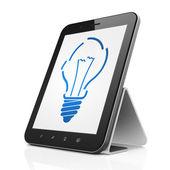 Finance concept: Light Bulb on tablet pc computer — Fotografia Stock
