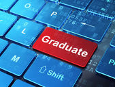 Education concept: Graduate on computer keyboard background — Foto Stock