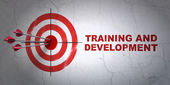 Education concept: target and Training and Development on wall background — 图库照片