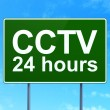 Privacy concept: CCTV 24 hours on road sign background — Stock Photo #45239113