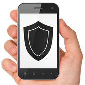 Security concept: Shield on smartphone — Stock Photo
