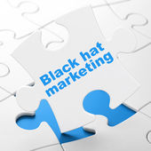 Business concept: Black Hat Marketing on puzzle background — Foto Stock
