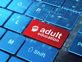 Education concept: Head With Gears and Adult Education on computer keyboard background — Stock Photo