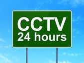 Privacy concept: CCTV 24 hours on road sign background — Stock Photo