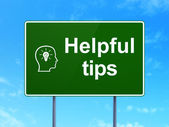 Education concept: Helpful Tips and Head With Lightbulb on road sign background — Stock Photo