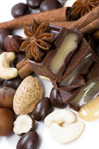 Chocolate with creamy stuffing, nuts and spices — Stock Photo