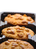 Sweet cookies poured by nuts peanut — Stock Photo
