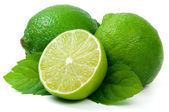 Juicy green lime isolated on white background. — Stock Photo