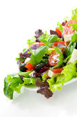 Salad from fresh vegetables, cheese mozzarella and olives, watered with olive oil — Stock Photo